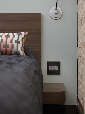adorne Light Switches, Outlets, and Wall Plates in hotel bedroom