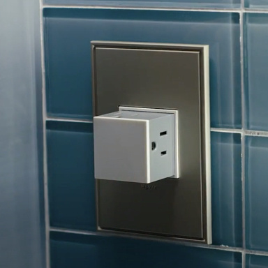 White pop-out outlet against blue tile wall