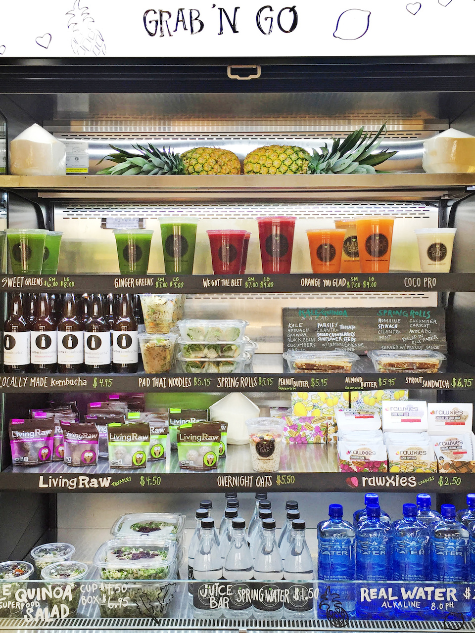 The grab 'n go cooler at Juice Bar offers a colorful array of healthy snacks and libations.