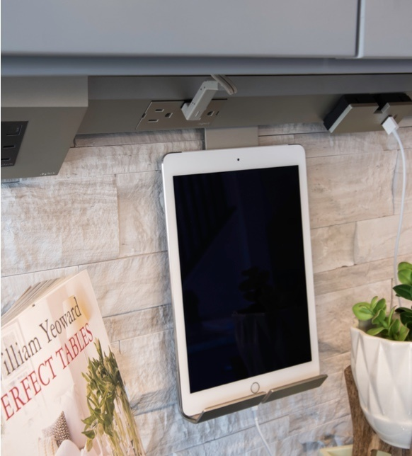 Tablet in gray kitchen held by cradle