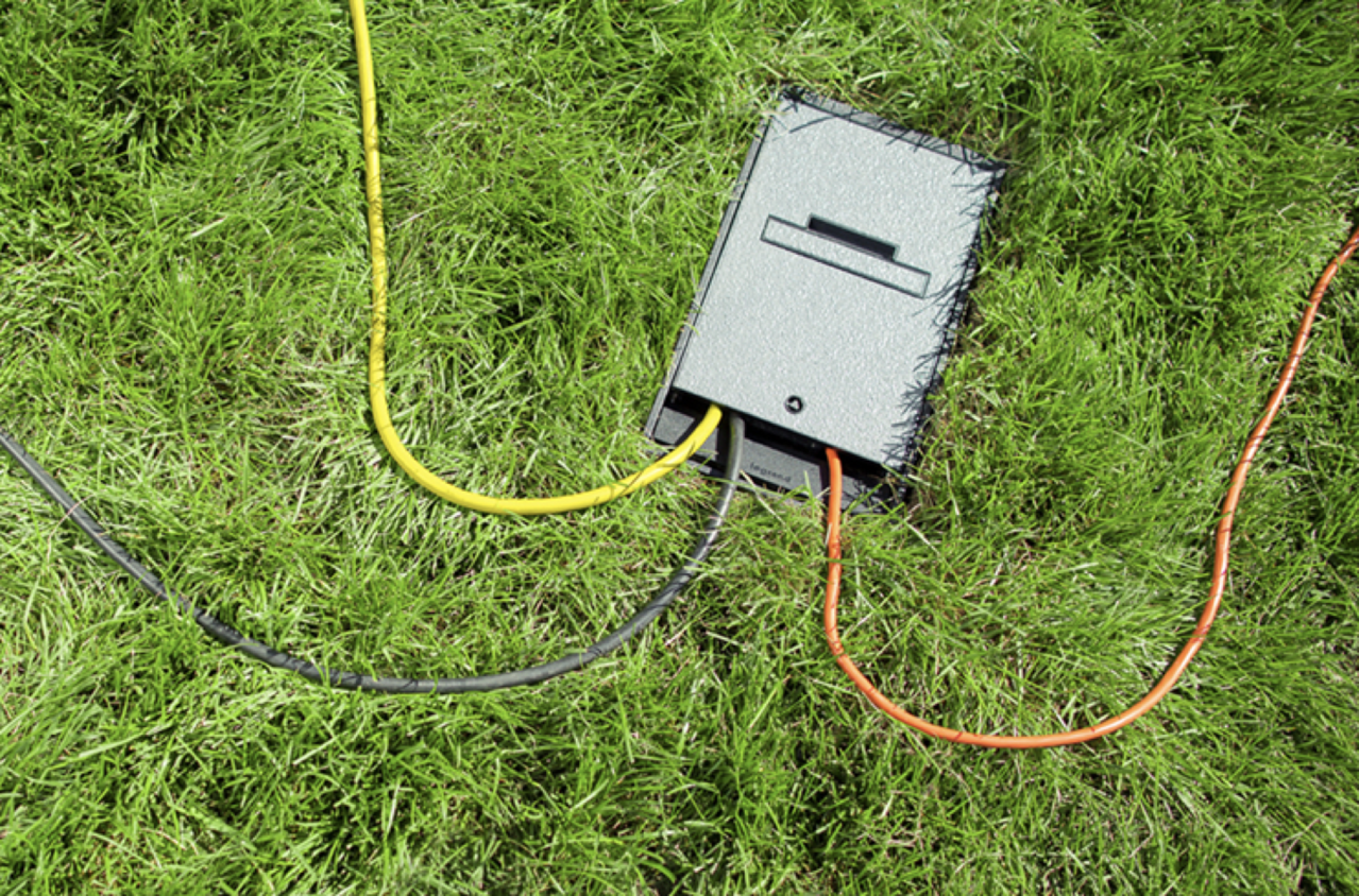 Outdoor ground box in ground with cables