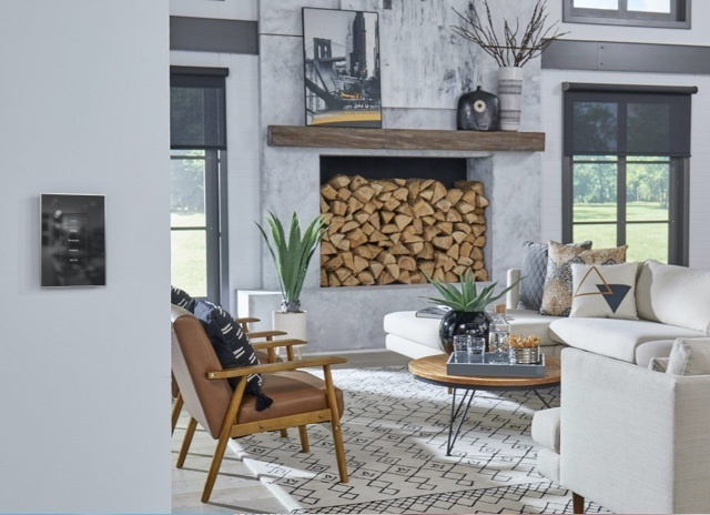 Living room area with a fireplace stocked with wood