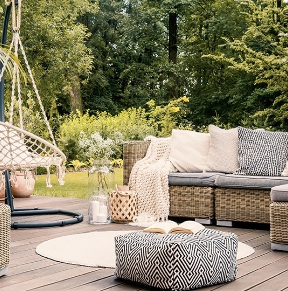 wicker patio furniture in backyard