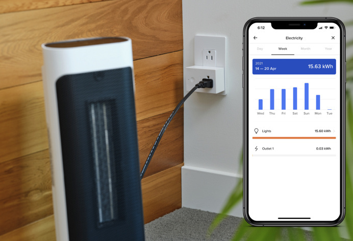 netatmo app on smart phone next to smart plug in switch