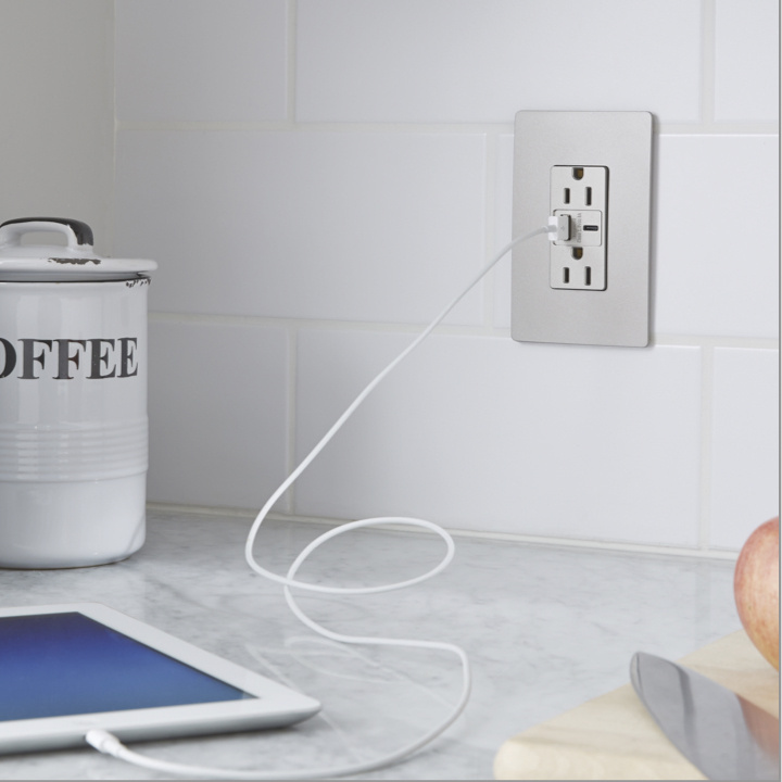 gray radiant ultra-fast USB and USB outlet charging iPad on kitchen counter