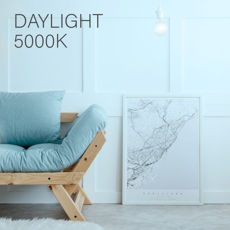 Wooden couch with blue cushions against a white wall and light blue overlay