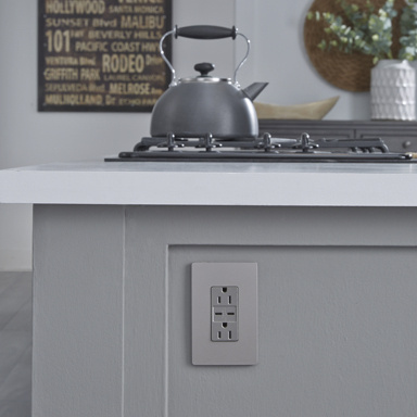 gray outlet blending into gray island in kitchen