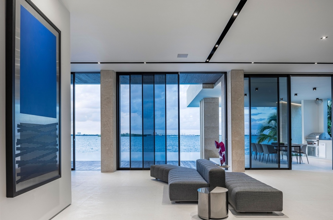 Sitting area with gray couches and view of the water