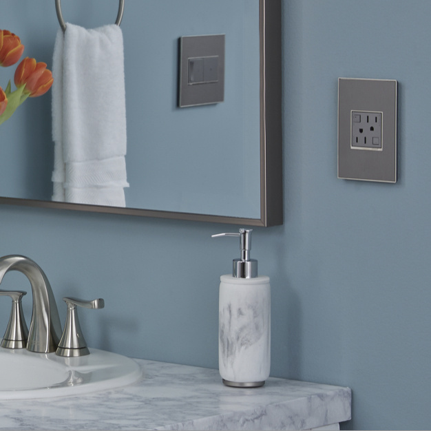 magnesium adorne outlet against blue wall in bathroom