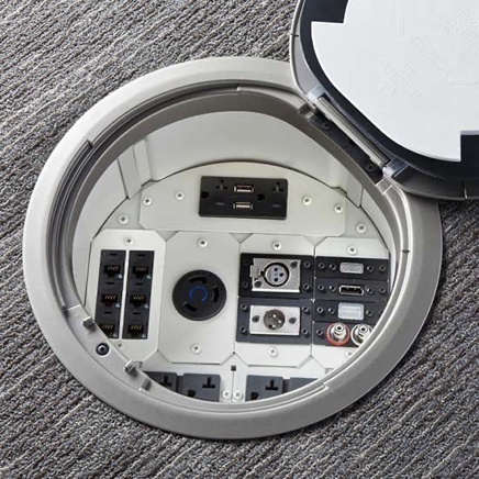 Evolution poke-thru device installed in carpet with cover open
