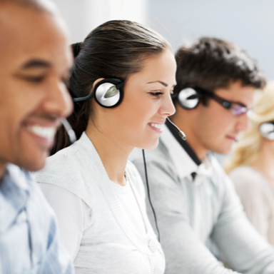 customer support representatives wearing silver headsets