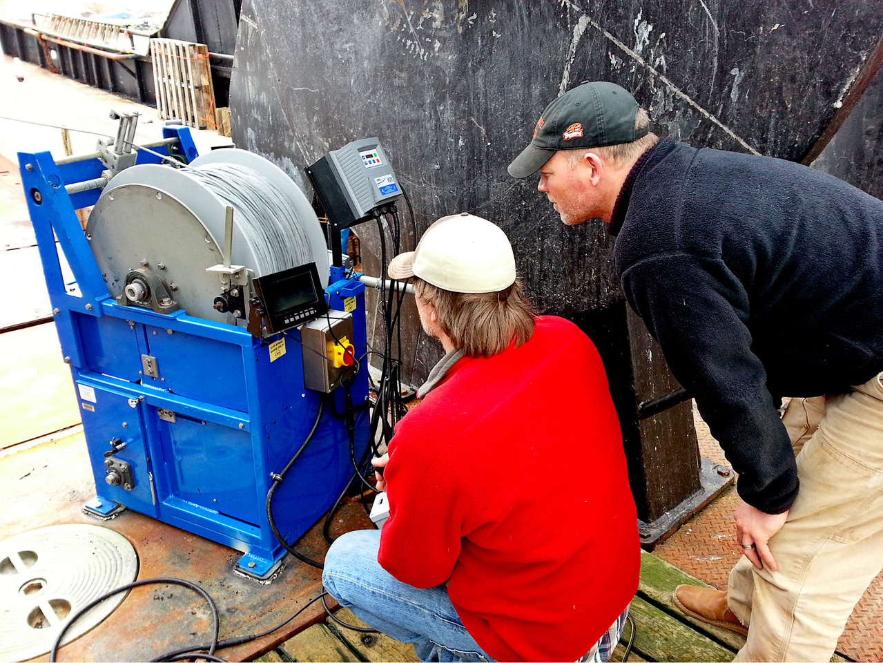Chris Rooper and John Olson (NMFS-Alaska Regional Office) operating the underwater camera system during a deployment in the Aleutian Islands