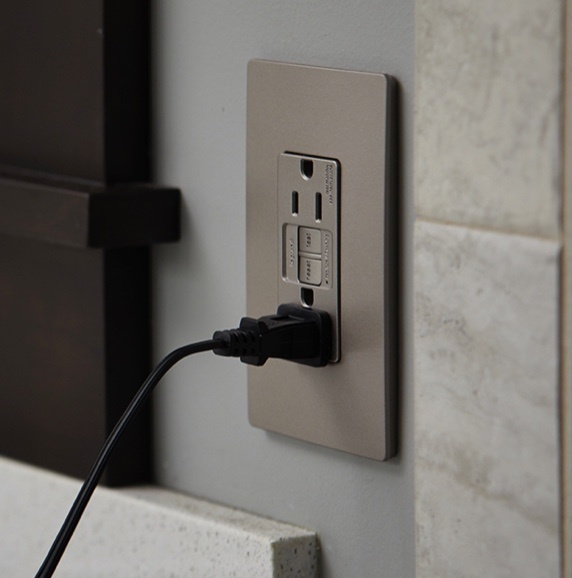 Legrand's radiant Collection GFCI Self-Test outlet shown in metallic Nickel