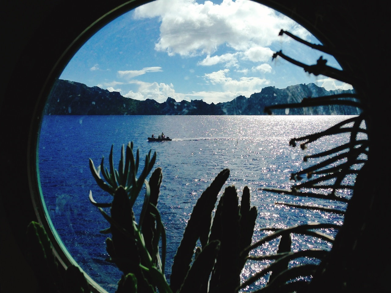 A porthole view of one of our small research vessels at Maug Island