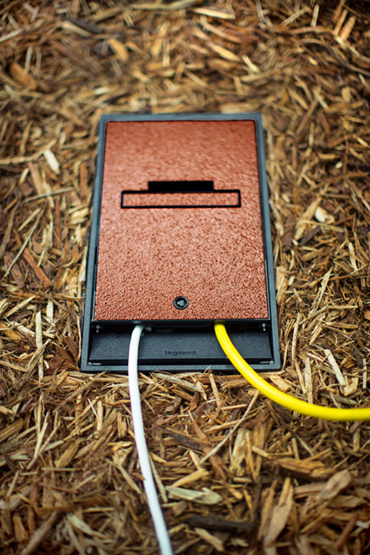 Wiremold Outdoor Ground Box in mulch