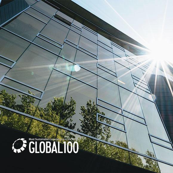 Sun shining on glass office building