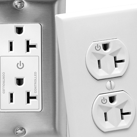 Two plug load outlets - one with white faceplate and one with stainless steel faceplate