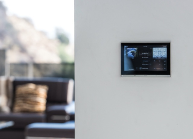 control panel on grey living room wall