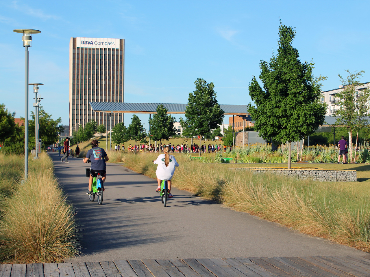 A couple explores the trails of Railroad Park on their Zyp bikeshare bikes.