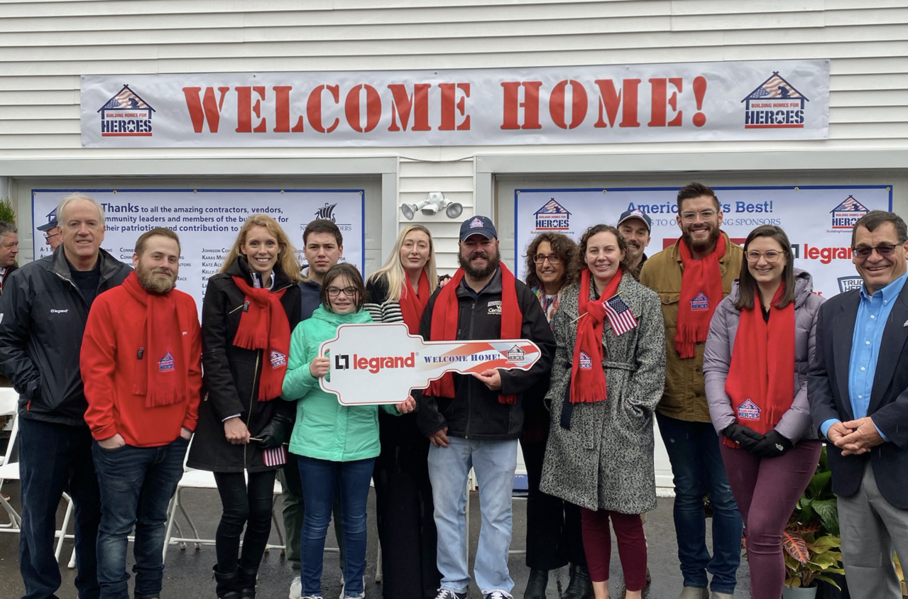 Legrand employees with Welcome Heroes home charity