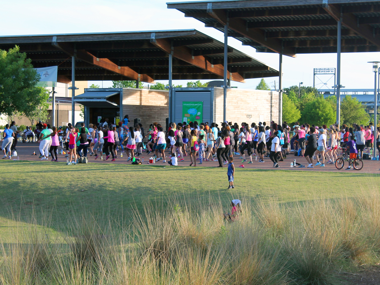 A Zumba class takes place on the shady pavilion at Railroad Park.