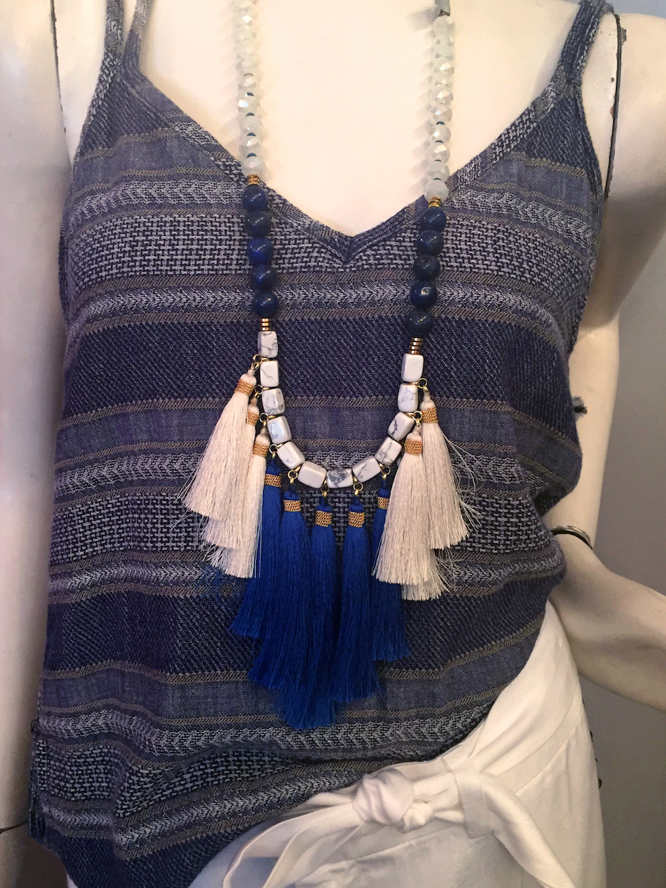 From Theadora Abbeyluxe: Blue and white tassel necklace, $88