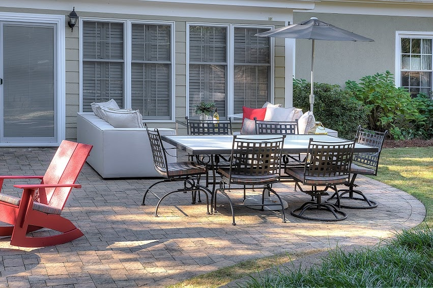 A patio table, outdoor couch and rocking chairs offer a ton of needed seating.