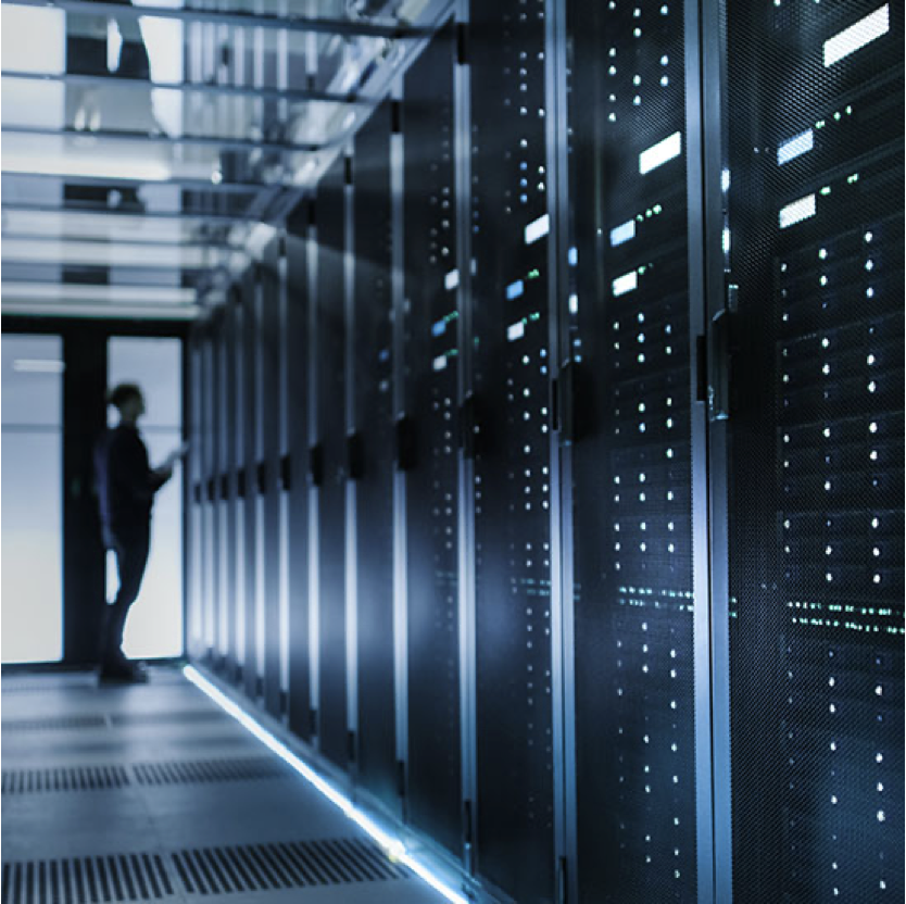 Person standing in front of a data center