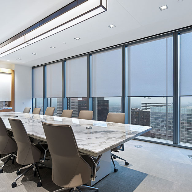 Conference room with shading on windows and overhead lights