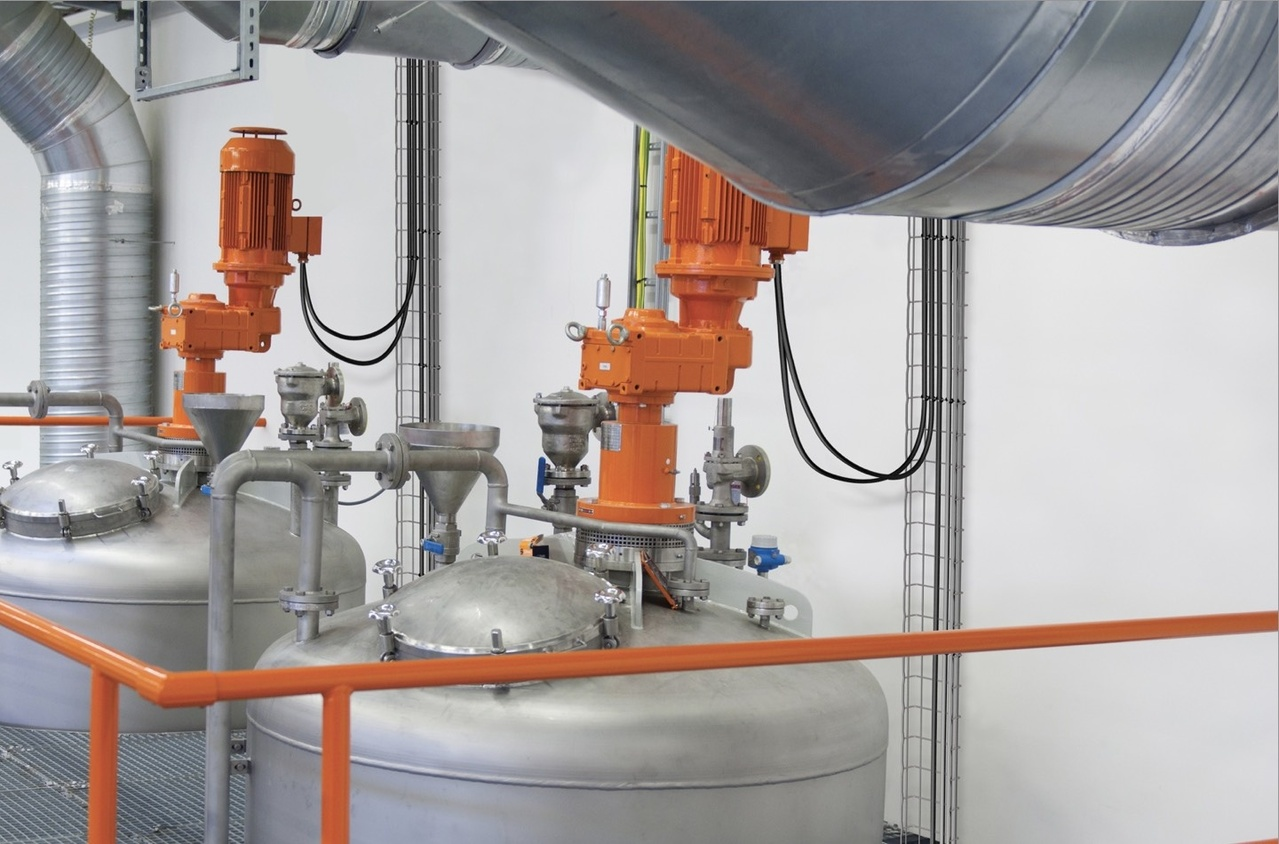 Stainless steel tanks for water and waste facility with orange lids