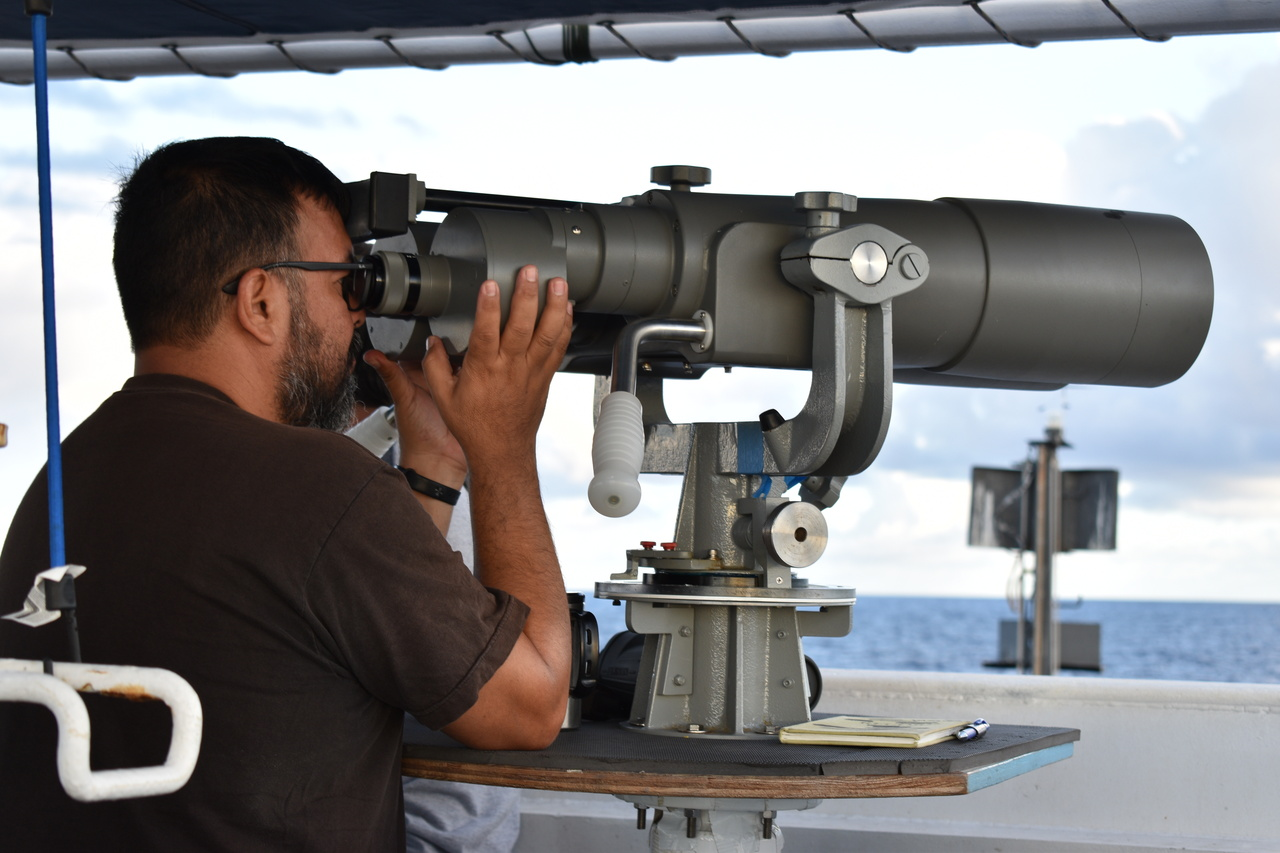 "Visual observers use ""big-eye"" binoculars to search for cetaceans as far as 7 nmi ahead of the ship."
