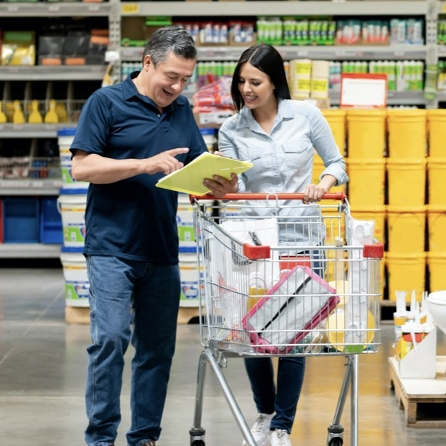 Couple shopping in a large wholesale store
