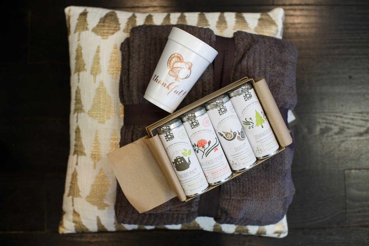 From the The Stovall Collection: Barefoot Dreams Blankey $165; disposable thankful cups, 8 for $8; pillow $62 and holiday cheer box of teas, $47.