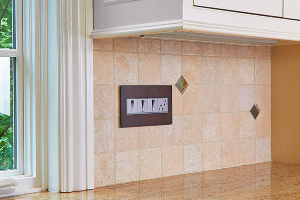 adorne Hubbardton Forge Mahogany Wall Plates in Kitchen with Whisper Switches and Outlet