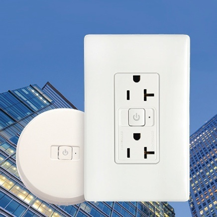 Plug load outlet and sensor against backdrop of commercial buildings