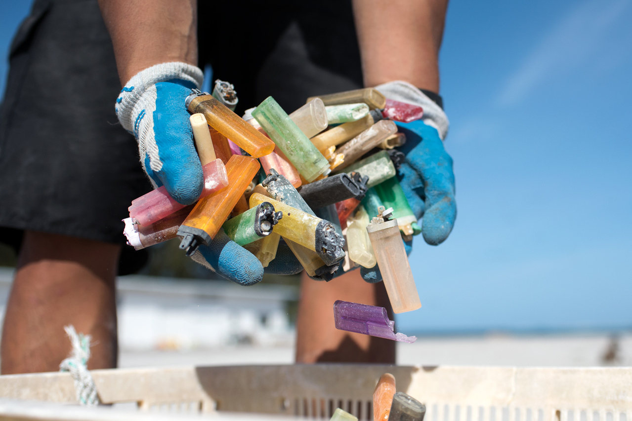On April 23, 2016, the team sorted debris  removed from the shorelines of Midway Atoll. Sixty percent of the 7077 kg (15602 lbs) debris collected has been sorted and tallied, and a total of 366 disposable cigarette lighters have been counted. Photo: NOAA Fisheries/David Slater