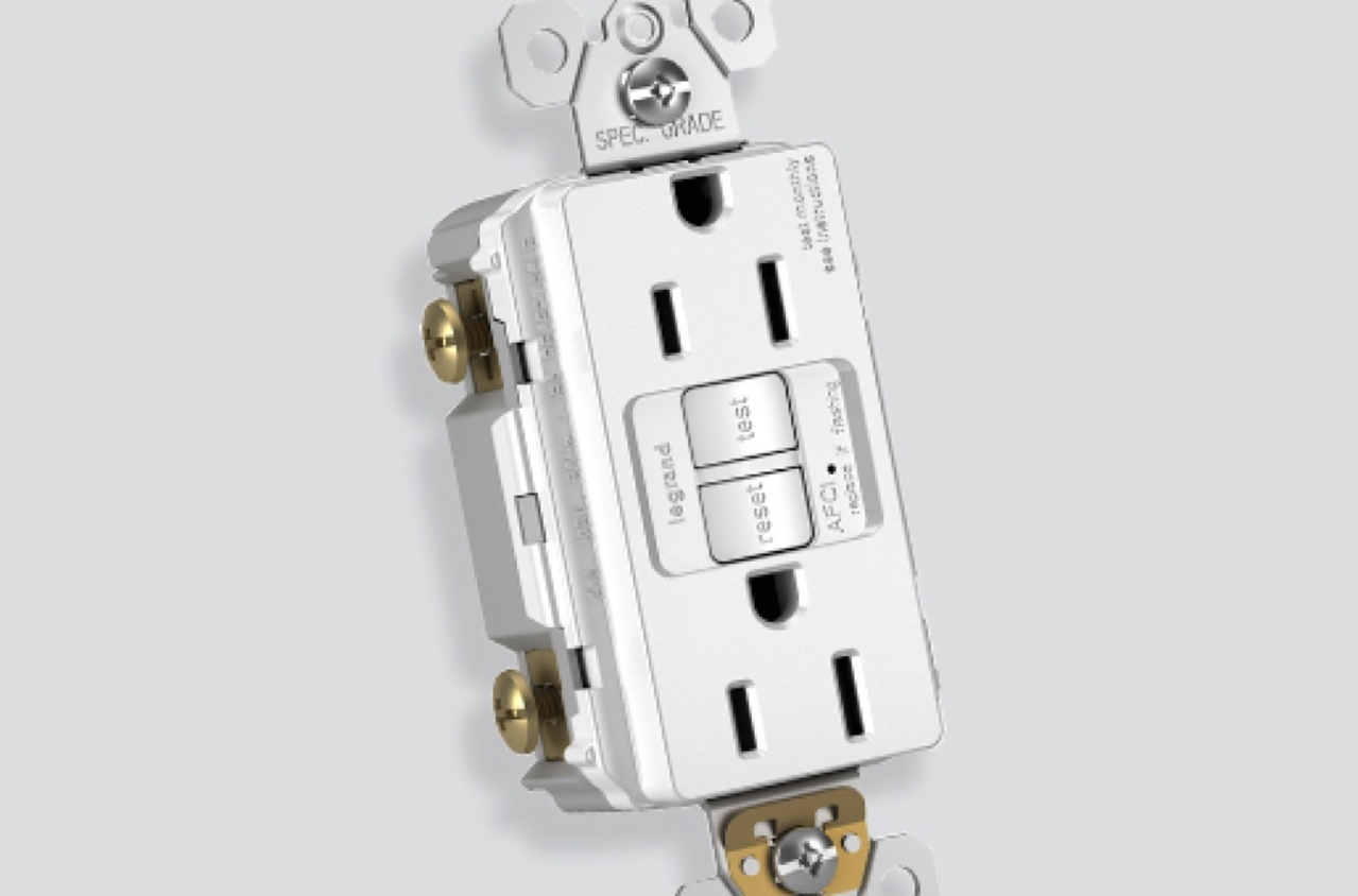Legrand AFCI outlet with visible mounting strap and screws over grey background