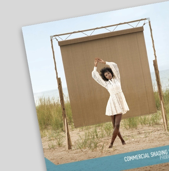 Commercial Shading Brochure with woman posing in front of a tan shade on the cover
