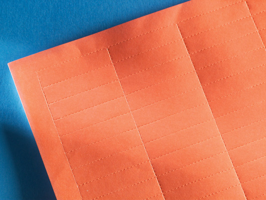 LabelMo paper stock for IMO in red, OR-70400411-22