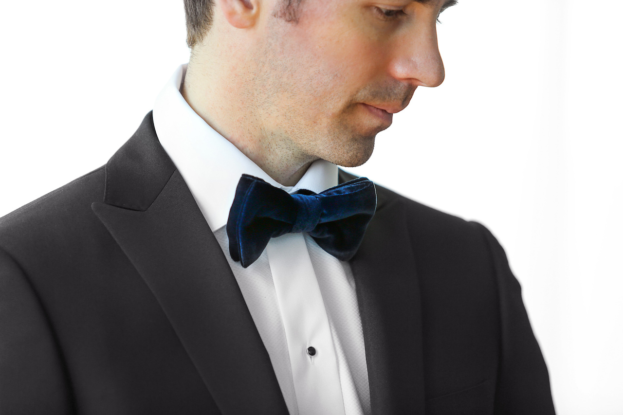 A velvet bowtie is a great way to update your standard tuxedo.
