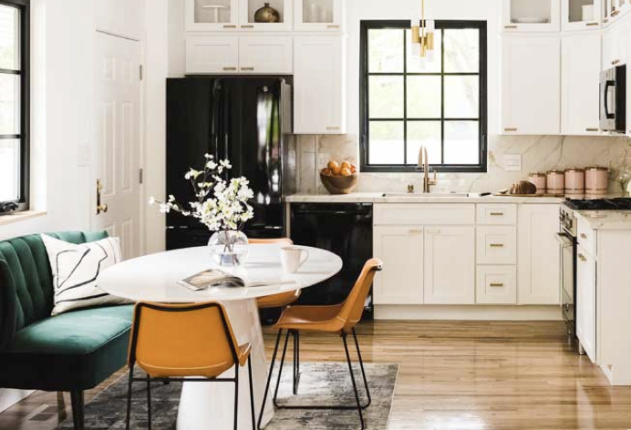 White upgraded kitchen with retro dining area