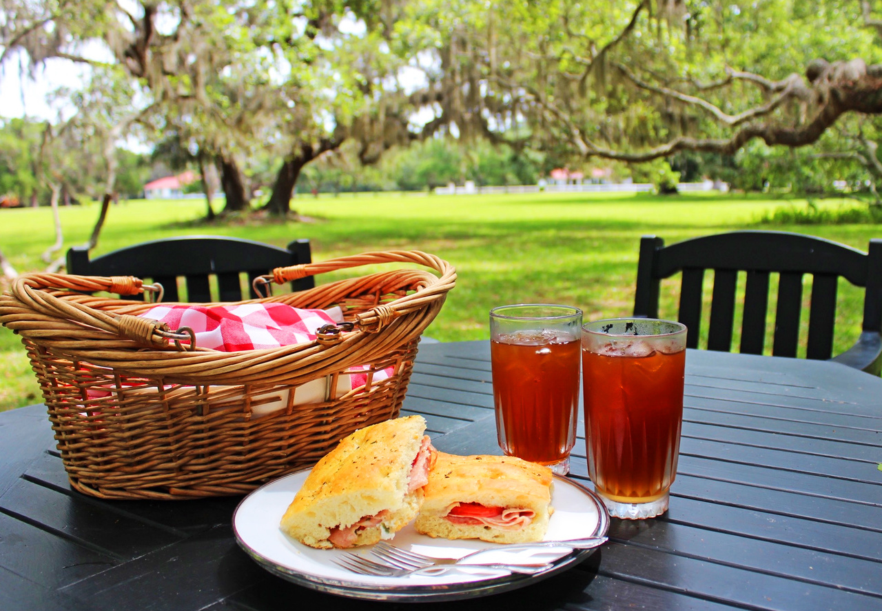 Lunchtime is easy and oh-so-civilized. Guests grab their already-prepared picnic baskets from the kitchen and can take them anywhere to eat, such as under this canopy of trees in the front yard.