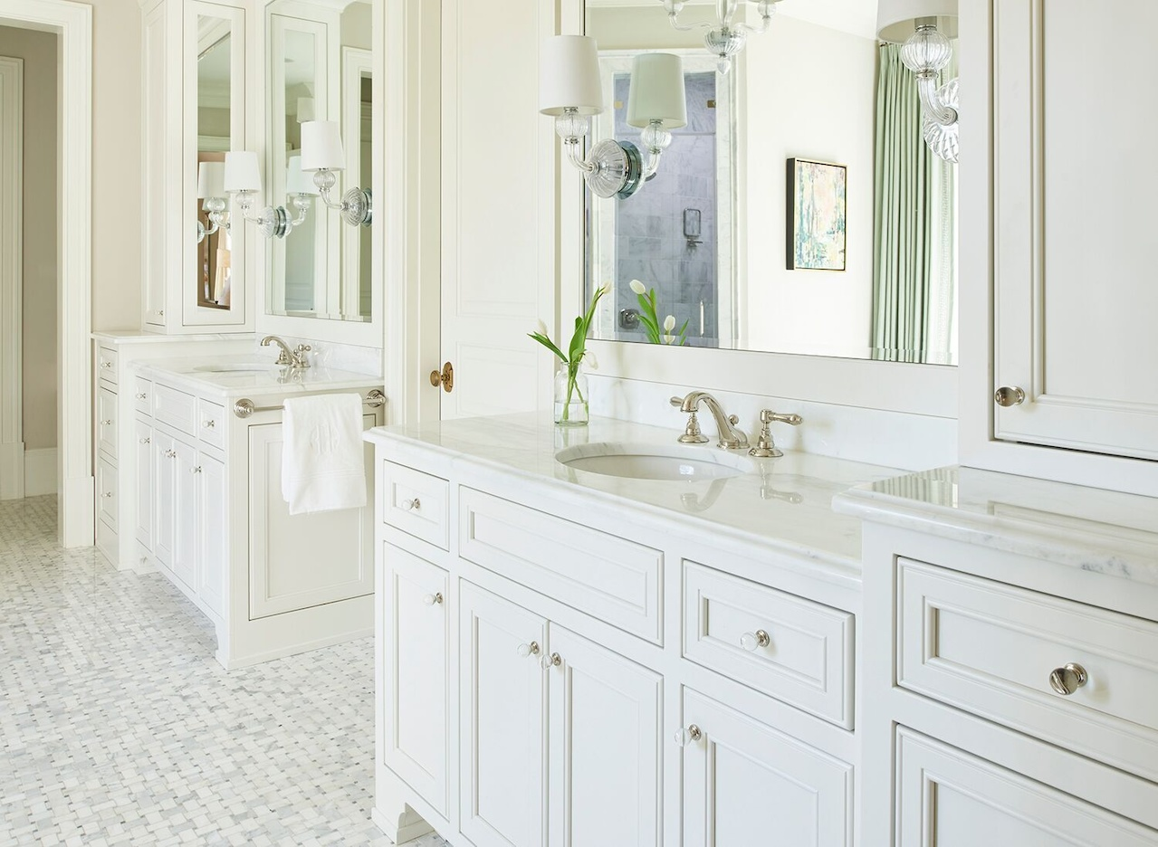 His-and-her custom vanities feature ample storage.