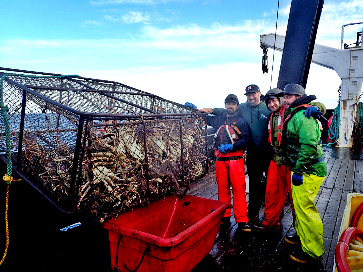 Crab survey captain and crew with the first crab pot of the day!