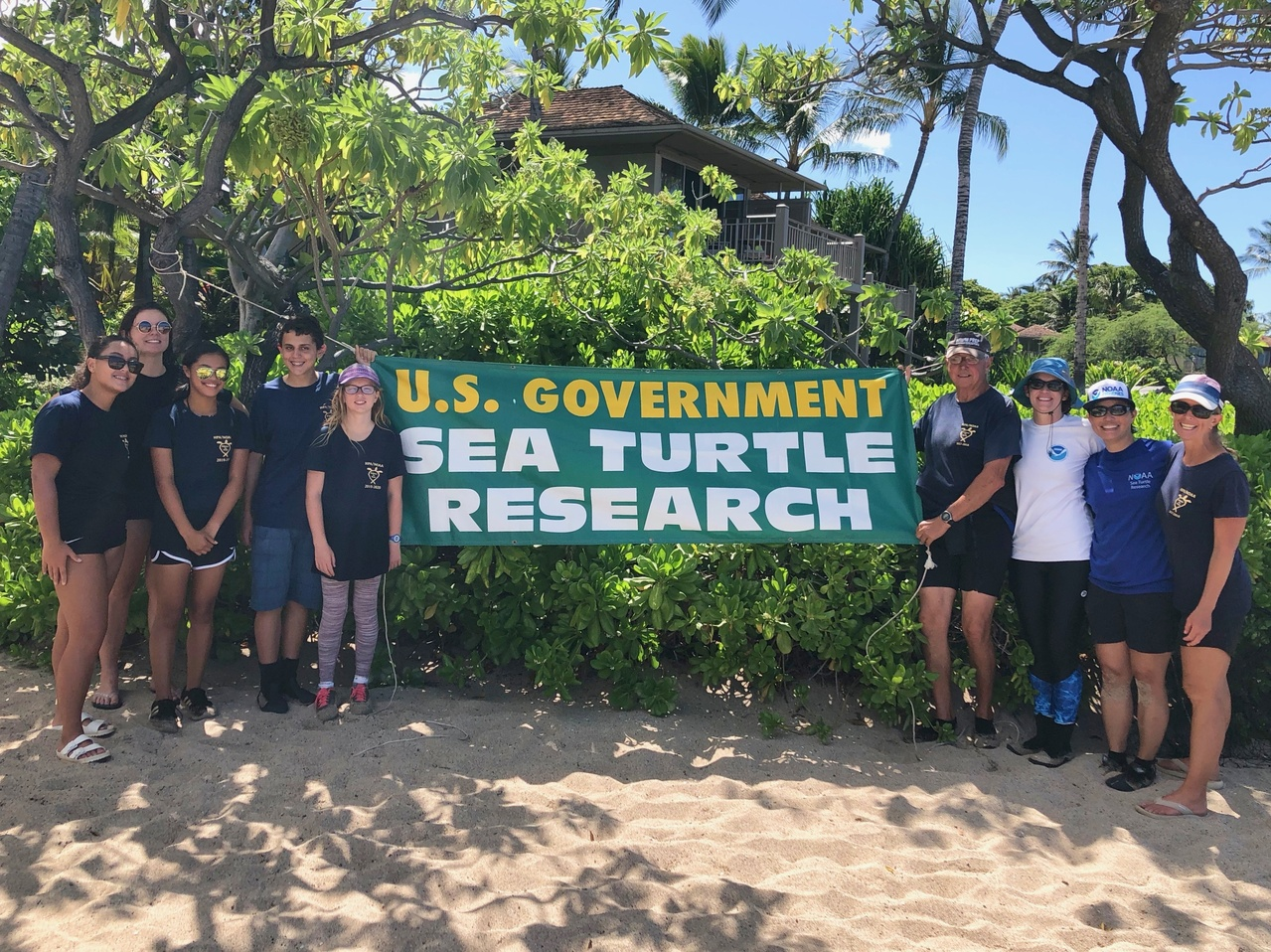 The Sea Turtle Research Group poses for a photo at Hualalai, Hawaii Island.