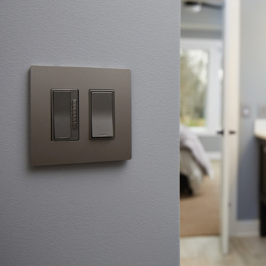 nickel dimmer and switch on blue wall