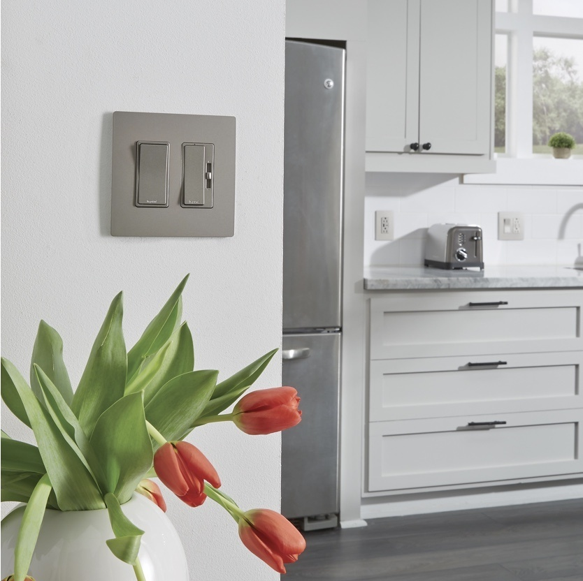 tulips next to gray radiant switch and dimmer in white kitchen