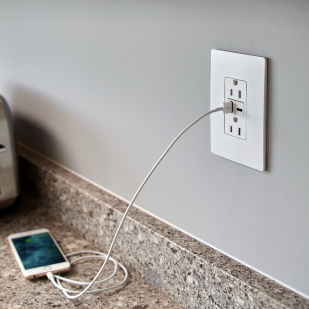 white radiant Collection by Legrand USB-A/C outlet with white designer wall plate on gray wall charging smart phone