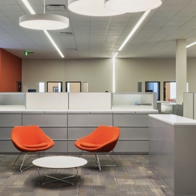 Round architectural lighting fixtures in commerical office