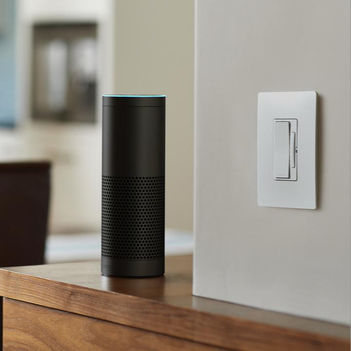 legrand smart lighting dimmer next to Amazon Alexa